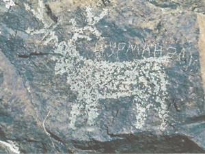 Петроглифы древних времен, обезображенные письменами наших современников